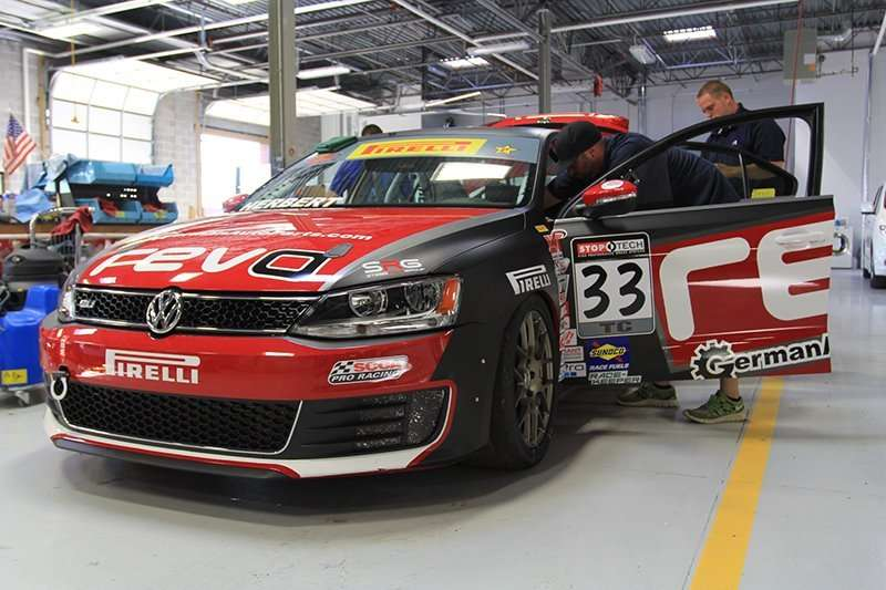 Image of a race car, the Brimtek Motorsports #33 Volkswagen GLI